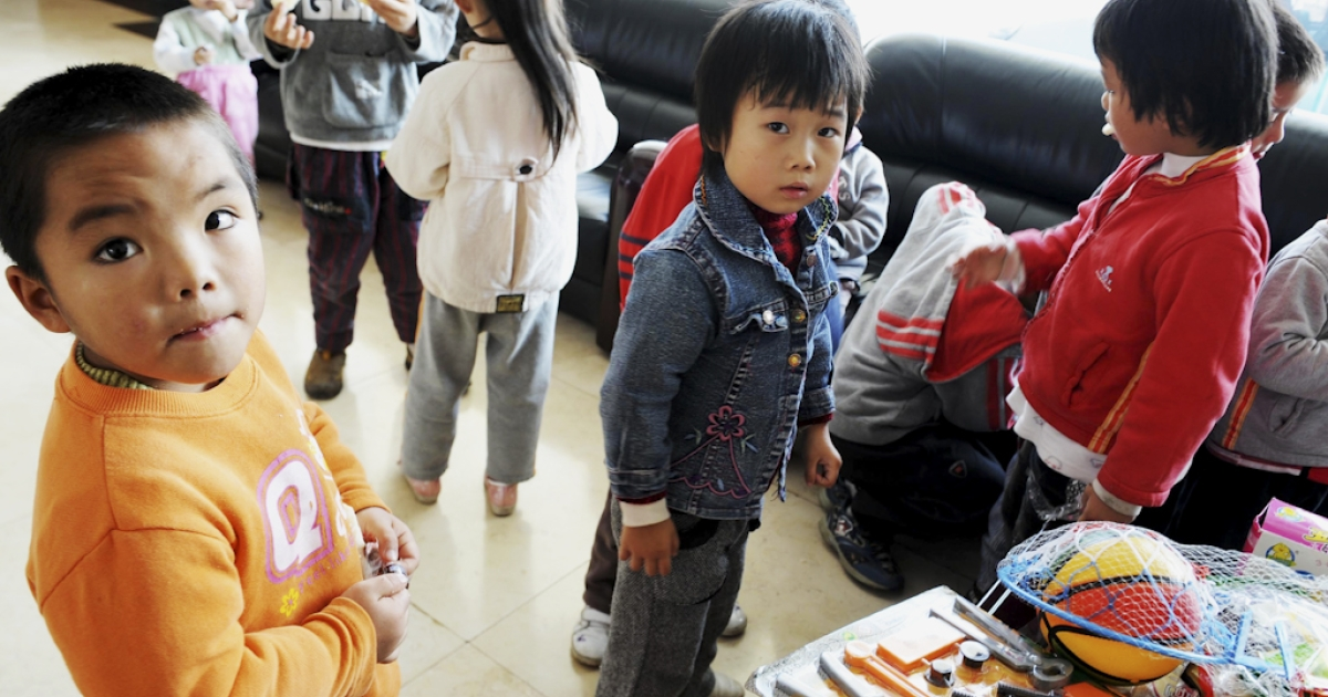 A group of 60 children are waiting to reunite with their parents after police rescued them from human traffickers at Guiyang Welfare Center for Children in Guiyang, southwest China's Guizhou province on October 29, 2009. Police in China on July 27, 2011 said they had rescued 89 trafficked children and arrested 369 suspects after uncovering two child trafficking gangs.</p>