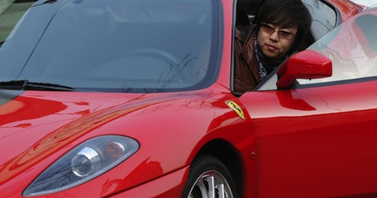 Li Fu, 29, climbs into his Ferrari on a street in Beijing. Li is one side of China's yawning wealth gap between rich and poor, a by-product of the country's stunning economic transformation, and a ticking time bomb at the heart of the ruling Communist Party's plan to revamp the economy.</p>
