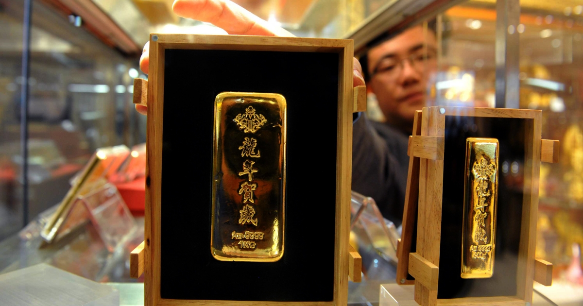 Bars of 2012 Lunar New Year gold on display in Beijing.</p>