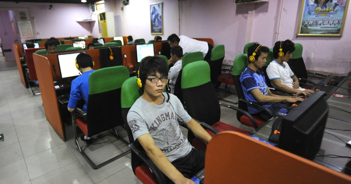 A young man uses a computer at an internet bar in Beijing, China.</p>