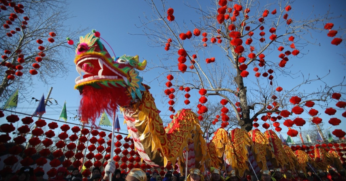 Chinese folk artists prepare to perform the dragon dance at a temple fair to celebrate the Lunar New Year of Dragon on Jan. 22, 2012 in Beijing, China. Falling on Jan. 23 this year, the Chinese Lunar New Year, also known as the Spring Festival, which is based on the Lunisolar Chinese calendar, is celebrated from the first day of the first month of the lunar year and ends with Lantern Festival on the Fifteenth day.</p>
