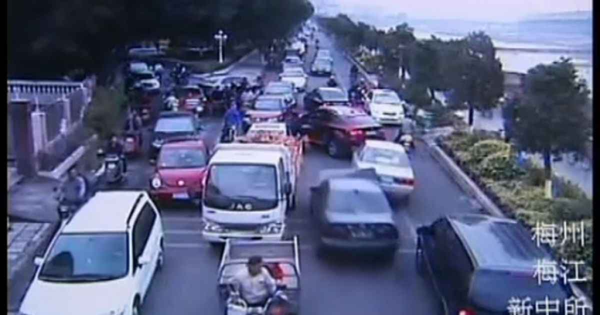 A Chinese man was caught on film crashing into motorbikes and cars to avoid arrest for stealing a car.</p>