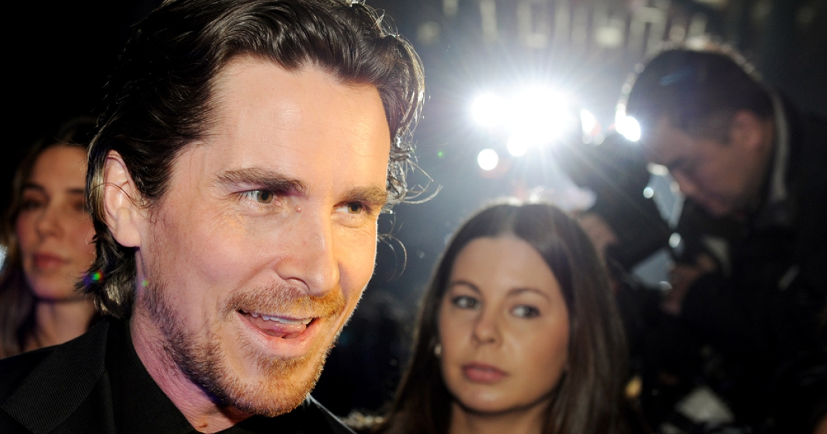 Batman star Christian Bale arrives on the red carpet for the screening of the film