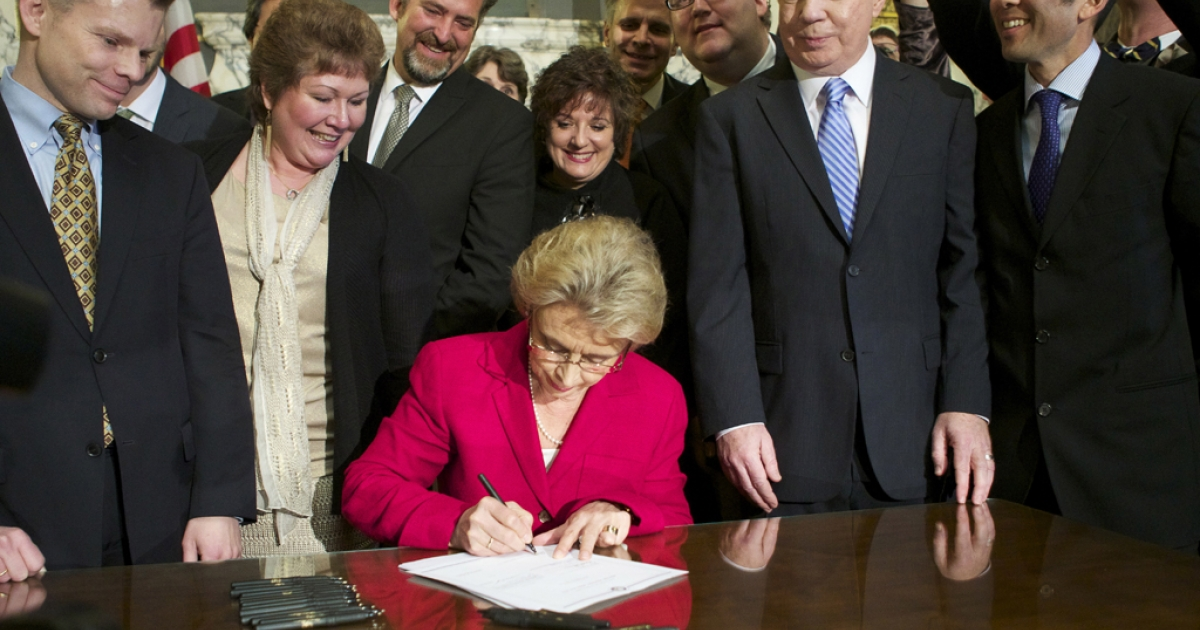Washington State Governor Chris Gregoire signs marriage equality legislation into law at the state capitol in Olympia, Washington. Washington state is the seventh state to legalize same sex marriage, however, before the law will go into effect it will most likely need to survive voter initiatives that would overturn it.</p>