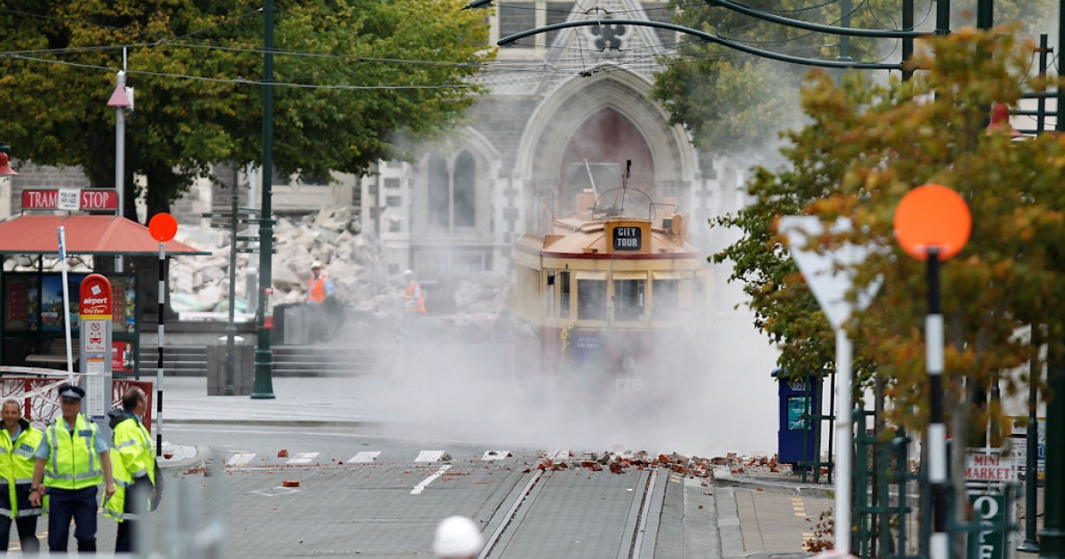 An iconic Christchurch tram is covered in debris on Feb. 22, 2011 in Christchurch, after New Zealand's second-largest city suffered a 6.3-magnitude earthquake.</p>