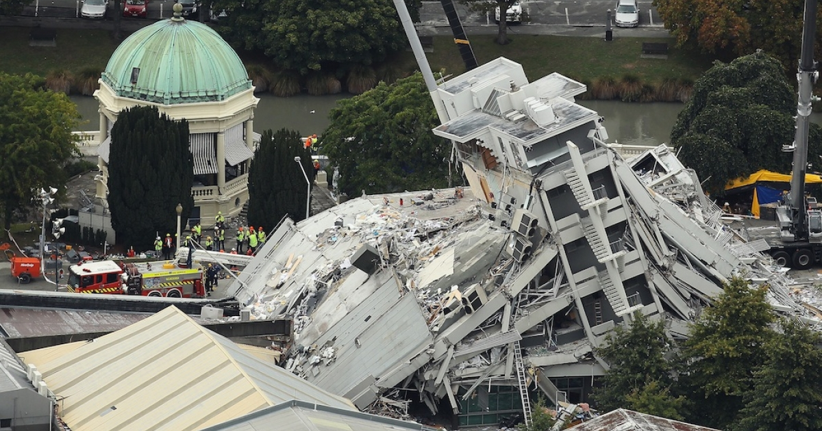 Rescue workers surround the Pyne Gould Guiness building on Feb. 23, 2011, in Christchurch, New Zealand.</p>