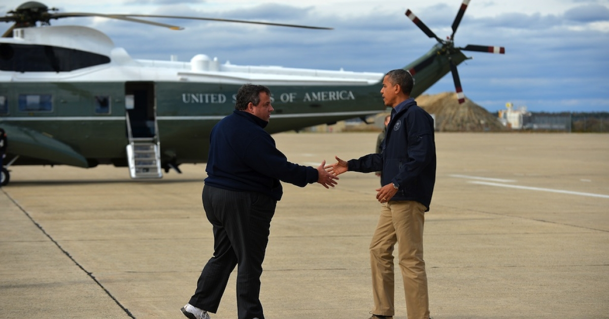 US President Barack Obama (R) is greeted by New Jersey Governor Chris Christie upon arriving in Atlantic City, New Jersey, on October 31, 2012 to visit areas hardest hit by the unprecedented cyclone Sandy. Americans sifted through the wreckage of superstorm Sandy on Wednesday as millions remained without power. The storm carved a trail of devastation across New York City and New Jersey, killing dozens of people in several states, swamping miles of coastline, and throwing the tied-up White House race into disarray just days before the vote.</p>