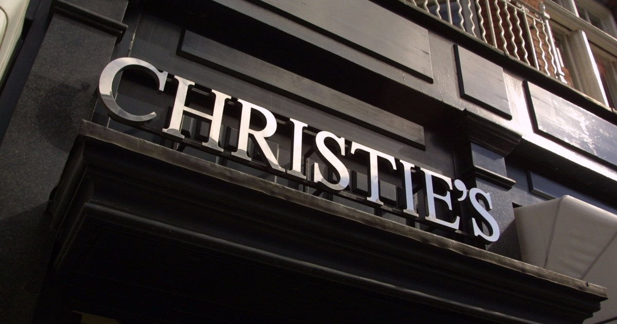The Christie''s logo is displayed over the entrance of the auction house July 13, 2001 on Old Brompton Street in London, England.</p>