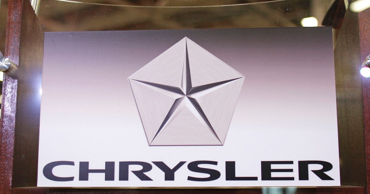 The Chrysler Group logo is attached to a podium at Chrysler's Jefferson North Assembly Plant. The company is planning on expanding its employee base, increasing investments and adding 1,250 new employees.</p>