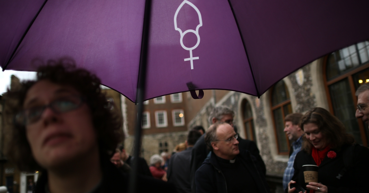 Supporters of the drive for women bishops display their campaign symbol last month, when the Church of England voted against the measure.</p>