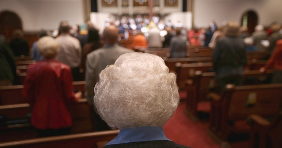 An elderly congregation member attends a Sunday service at the First Presbyterian Church on Oct. 28, 2012 in Warren, Ohio.</p>