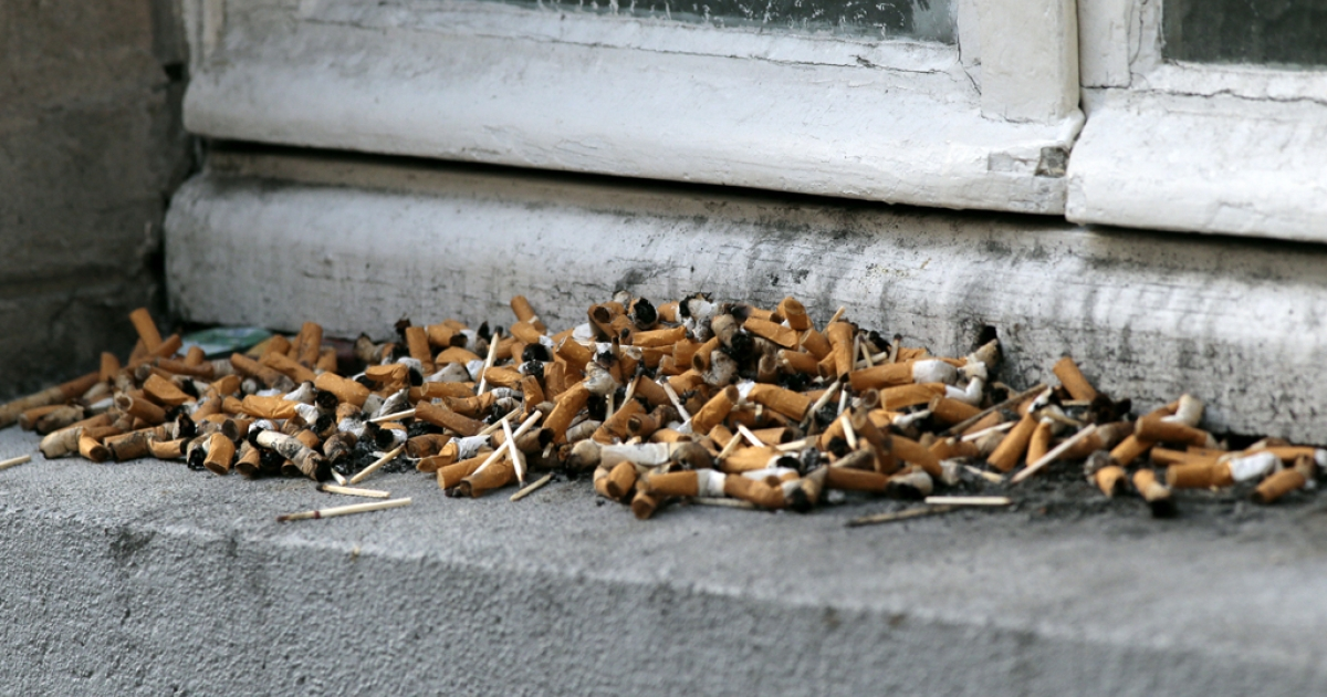 This picture taken on Oct. 25, 2012, shows cigarette butts on a window edge used as an ashtray in Paris.</p>