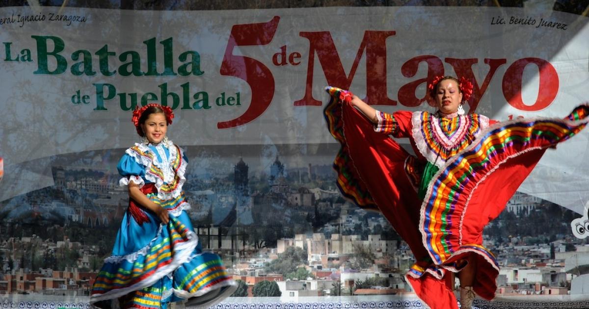 Aracely Saucillo (L) and Marylin Castillo perform with Mexica Ballet Folclorico during Cinco De Mayo festivities on May 5, 2011, at El Pueblo de Los Angeles Historic Site on Olvera Street in downtown Los Angeles, California.</p>