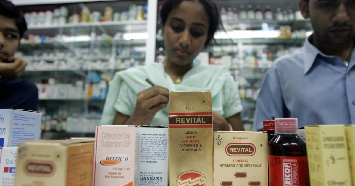 An Indian staff checks batch numbers of ranbaxy medicines at a shop in Mumbai 26 October 2005.</p>