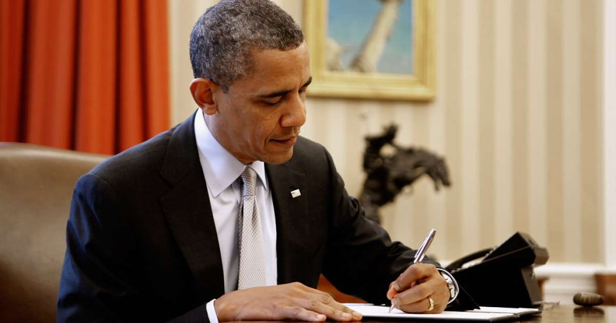 U.S. President Barack Obama signs a proclamation to designate federal lands within the former Fort Ord as a national monument in the Oval Office of the White House April 20, 2012 in Washington, DC. According to the White House,