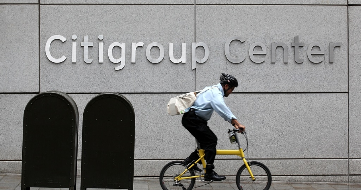 A cyclist rides his bike past the Citigroup center on April 18, 2011 in San Francisco, California.</p>