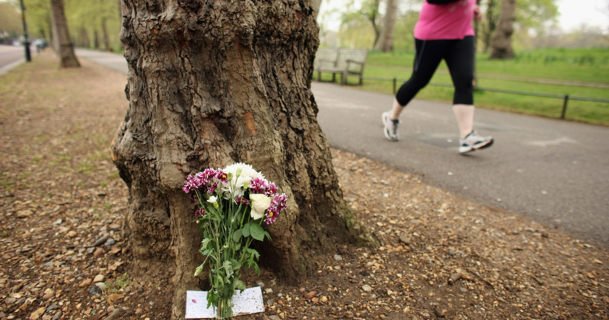 Floral tributes are left on Birdcage Walk in London on April 24, 2012, for Claire Squires who died on Sunday while competing in the London Marathon.</p>