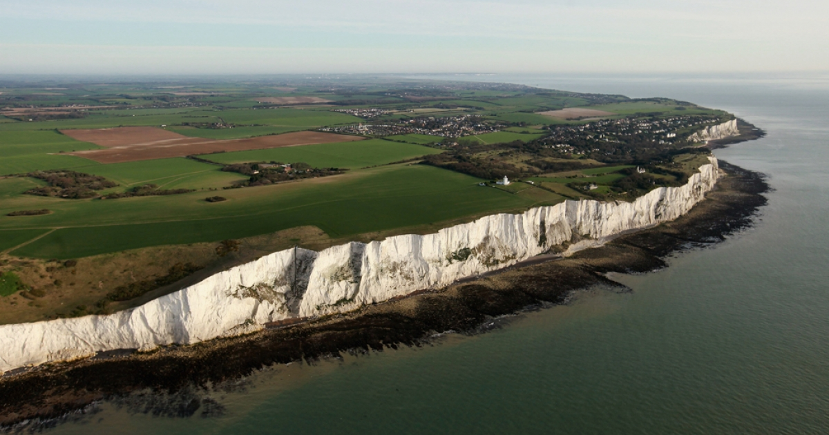 The white cliffs of Dover are seen from the air in Dover, England. The chalk cliffs, which at points stand over 100 metres high, represent the closest point in England to mainland Europe.</p>