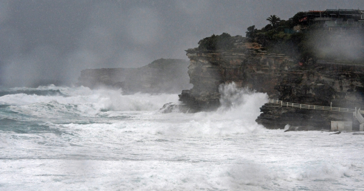 Wild surf breaks on cliffs on the coast of Sydney. Don Ritchie, a local hero who was also known as