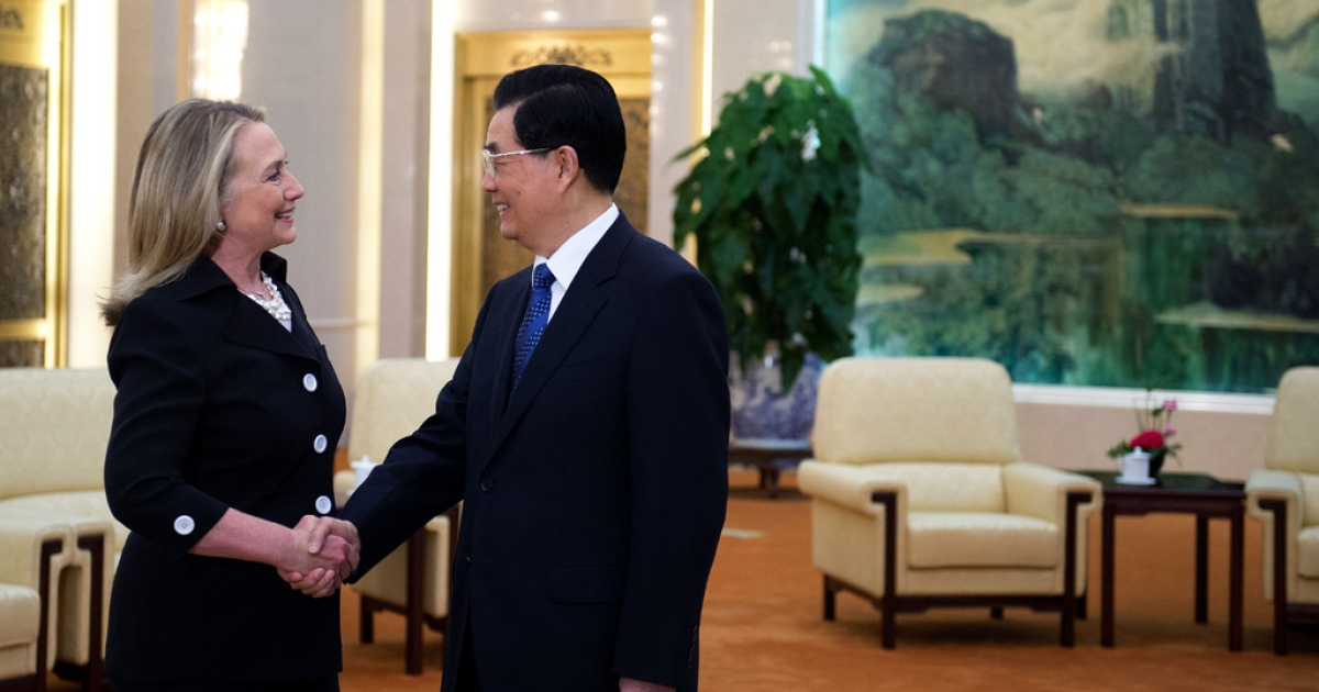 Chinese President Hu Jintao shakes hands with US Secretary of State Hillary Clinton during her visit to the Great Hall of the People in Beijing on September 5, 2012.</p>