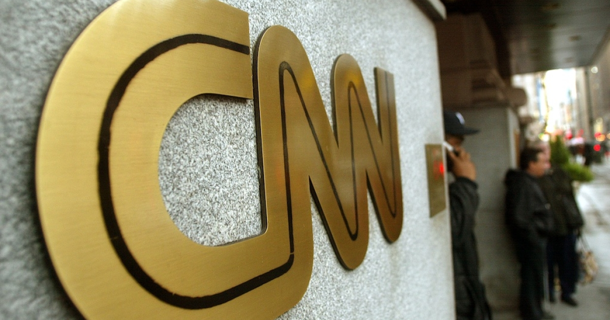 The CNN sign is seen outside its headquarters November 12, 2002 in New York City.</p>