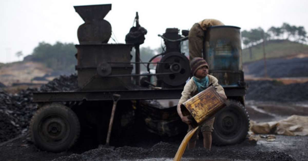 A boy works at a coal depot on April 16, 2011 near to Lad Rymbai, in the district of Jaintia Hills, India. Local schools in the area, providing free tuition, find it difficult to convince parents of the benefits of education, as children are seen as sources of income. The lure of the mines is stronger than that of the classroom.</p>