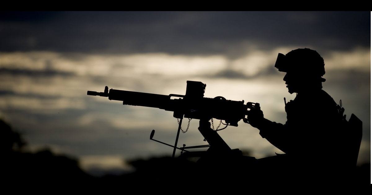 Gunning for peace? A Colombian army soldier mans a turret machine gun in Miranda, in the Cauca department, as part of a task force to fight the FARC guerrilla group. Violence between the military and FARC has escalated even as the groups prepare for peace talks.</p>