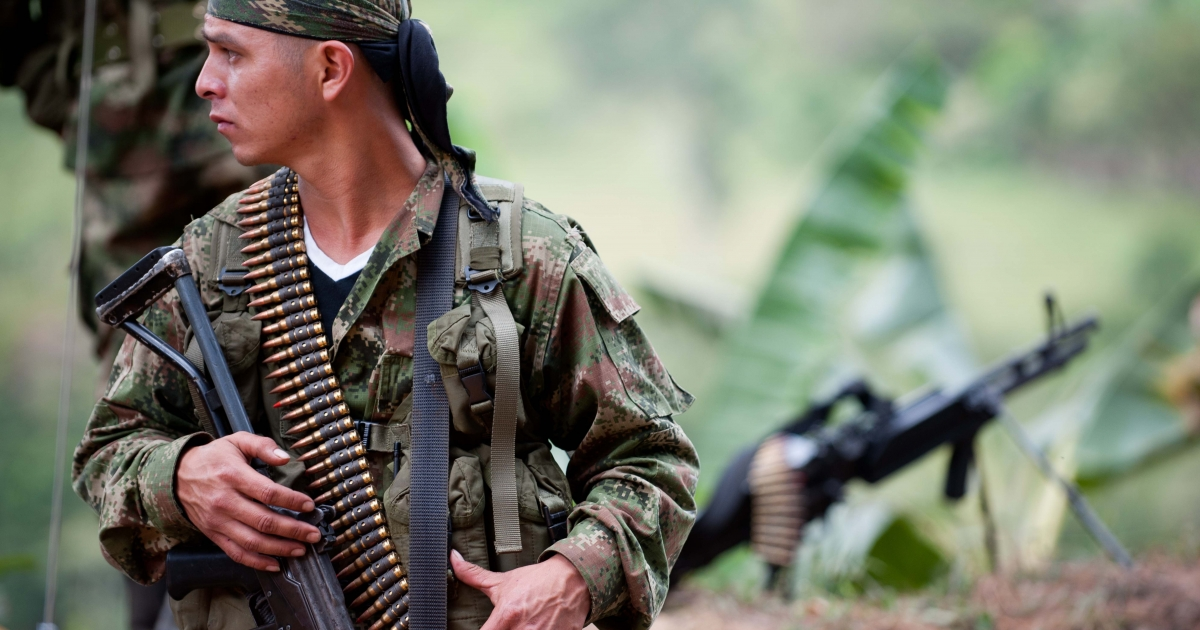 A member of the Revolutionary Armed Forces of Colombia (FARC) guerrillas mans a checkpoint near the town of Toribio, in the Colombian department of Cauca.</p>