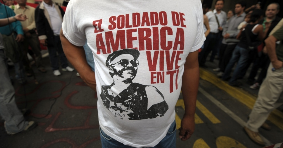 A Bolivian activist wears a T-shirt with the picture of killed FARC leader Raul Reyes and a inscription that reads