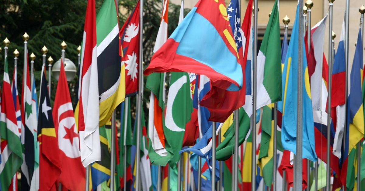 Numerous national flags in front of the United Nations office in Geneva, Switzerland.</p>