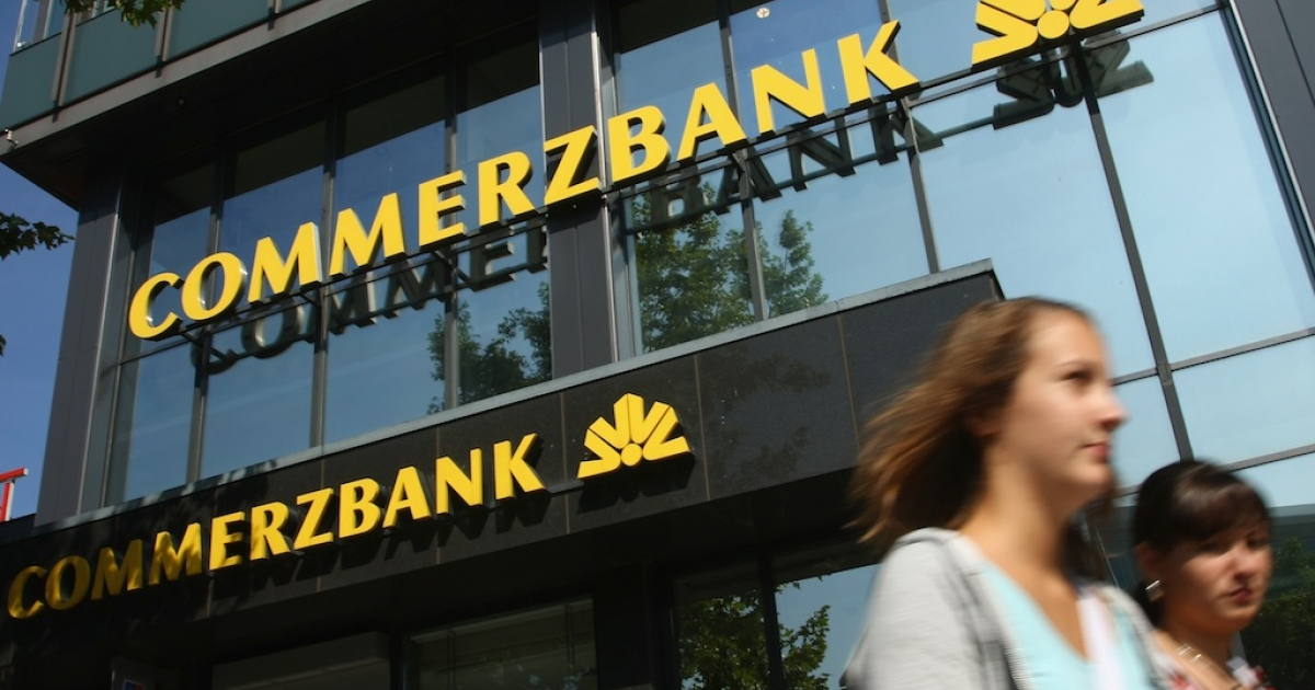 People walk past a branch of Commerzbank on Sept. 2, 2008 in Berlin, Germany.</p>