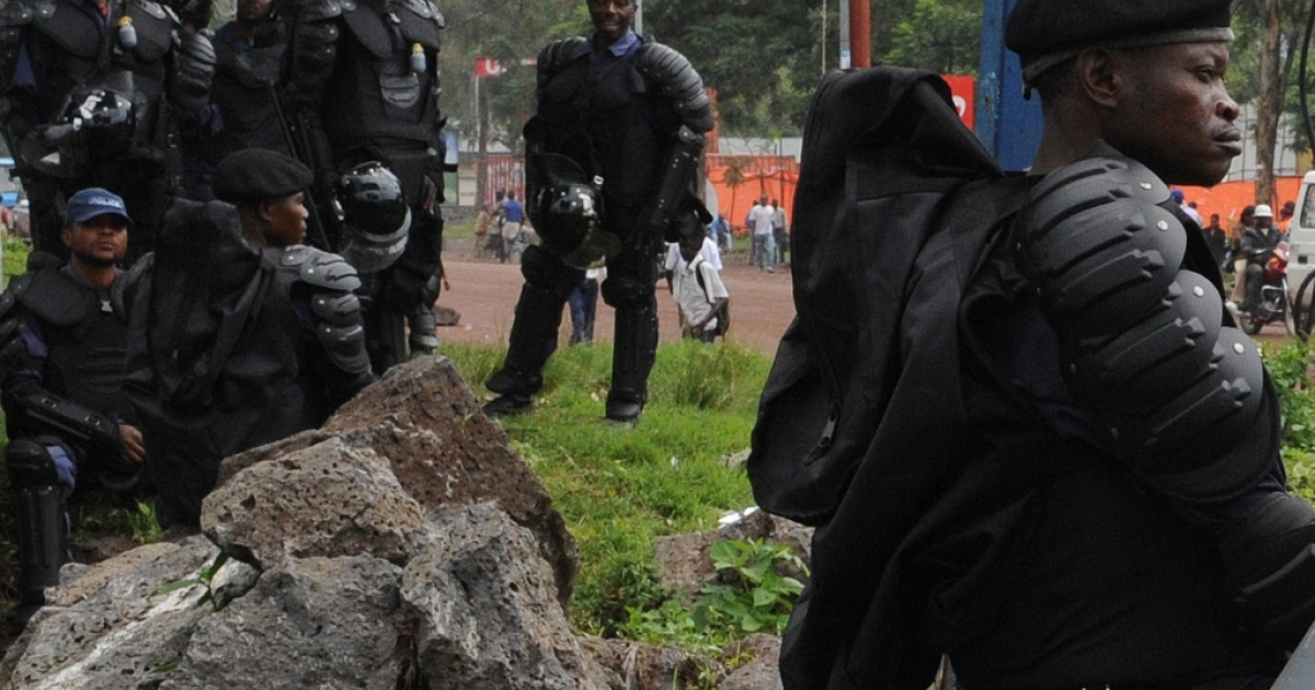 Congolese riot-policeman stand guard on the streets of Goma, in eastern Congo on December 6,2011. Across the country, in Kinshasa, police fired tear gas to disperse opposition supporters as tensions were running high in the Democratic Republic of Congo as the announcement of the winner of last week's elections have been delayed until Dec. 8. The giant central African country is on high alert after a campaign that saw deadly police crackdowns on opposition rallies and a series of clashes between rival parties.</p>