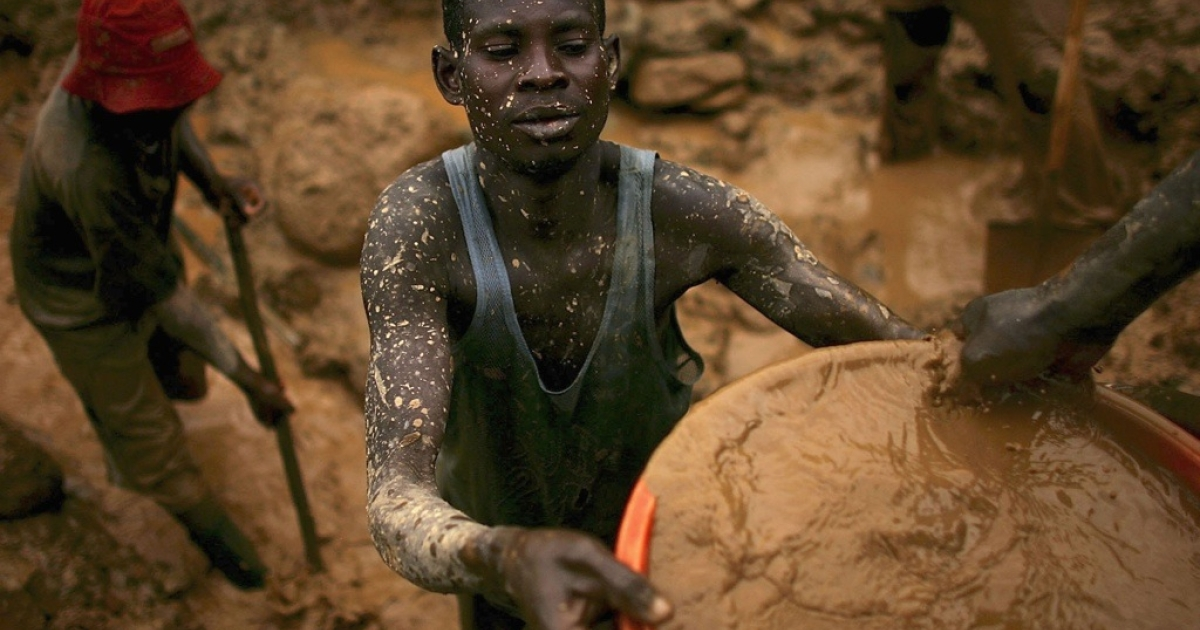 Miners sift through buckets of mud for gold in Mongbwalu, eastern Congo.</p>