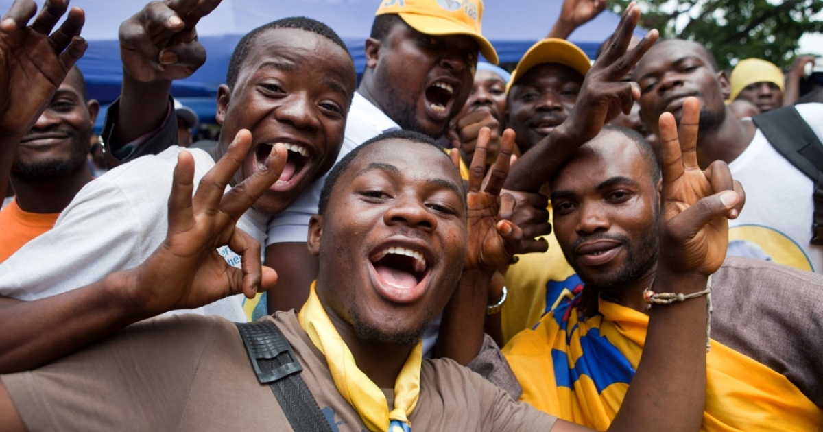 Supporters of the People Party for the Reconstruction and the Democracy (PPRD) celebrate the election of president Joseph Kabila for a second mandate on December 17, 2011 in Kinshasa.</p>