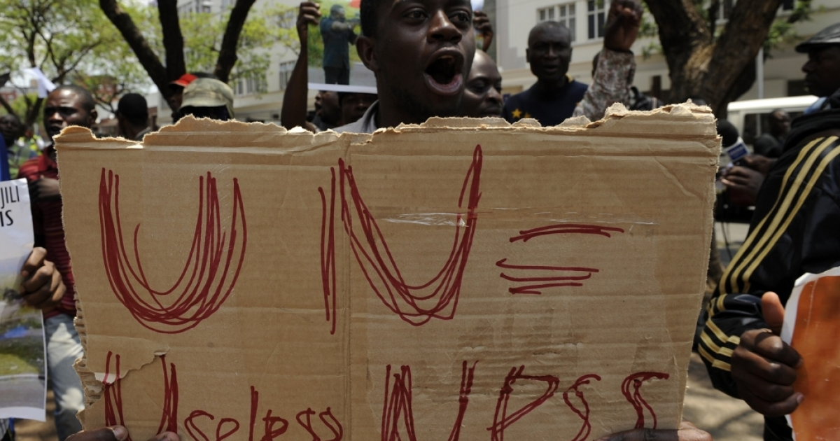 A man takes part in a demonstration on Nov. 27 in front of the UN headquarters in Pretoria against UN peacekeeping troops in Goma failing to protect women and children against the M23 rebels.</p>