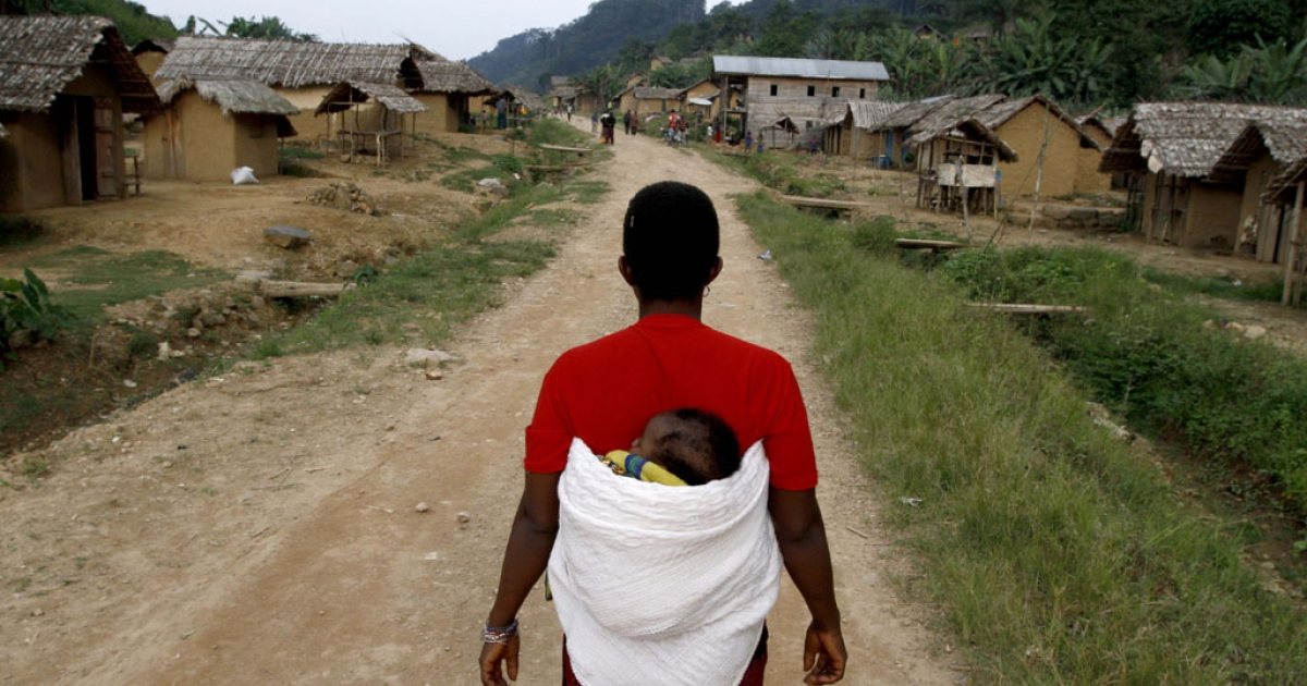 A Congolese woman walks down the main road in Luvungi, a village in eastern DRC. The country has been named the world's worst place to be a mother by charity Save the Children.</p>