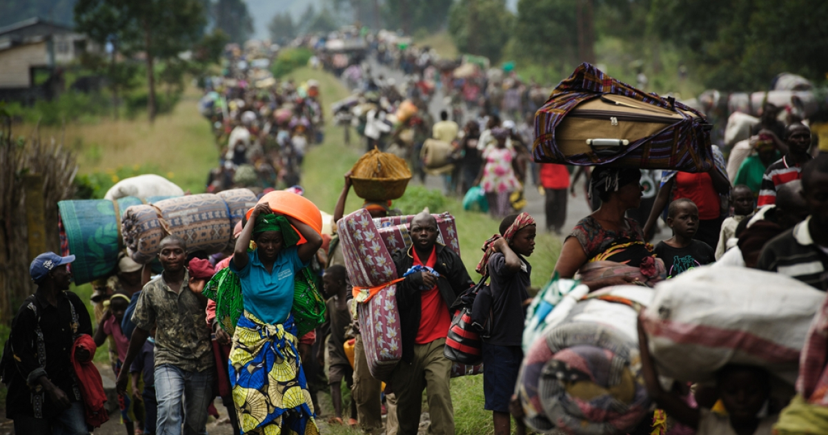 Thousands of Congolese flee the town of Sake, 26km west of Goma, following renewed fighting in the eastern Democratic Republic of the Congo town on Nov. 22.</p>