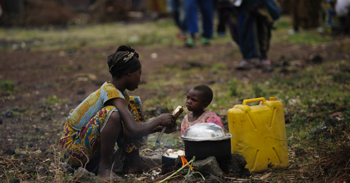 A displaced Congolese woman from Kibumba sits with her child in the Democratic Republic of Congo on July 25, 2012. The World Health Organization warned that an outbreak of the Ebola virus could get out of control and spread to major towns.</p>