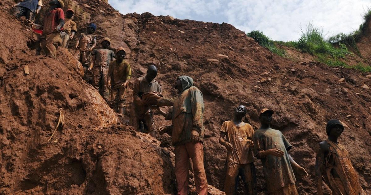 Men work in a gold mine on Feb. 23, 2009, in Chudja, near Bunia, north eastern Congo.</p>