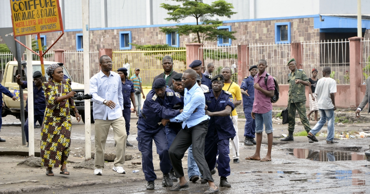 Police arrest a Catholic leader as Congolese Christians demonstrate in the capital, Kinshasa on February 16, 2012.  The church says presidential and parliamentary elections last year were tainted with irregularities.</p>