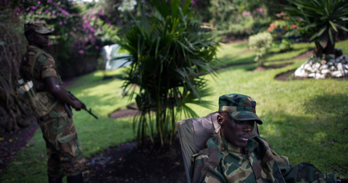 The head of the M23 rebel military forces, Brigadier-General Sultani Makenga (R), sits on November 25, 2012 in the yard of a military residence in Goma in the east of the Democratic Republic of the Congo. Over half a million people have been displaced  in eastern Congo since the outbreak of the M23 rebellion.</p>