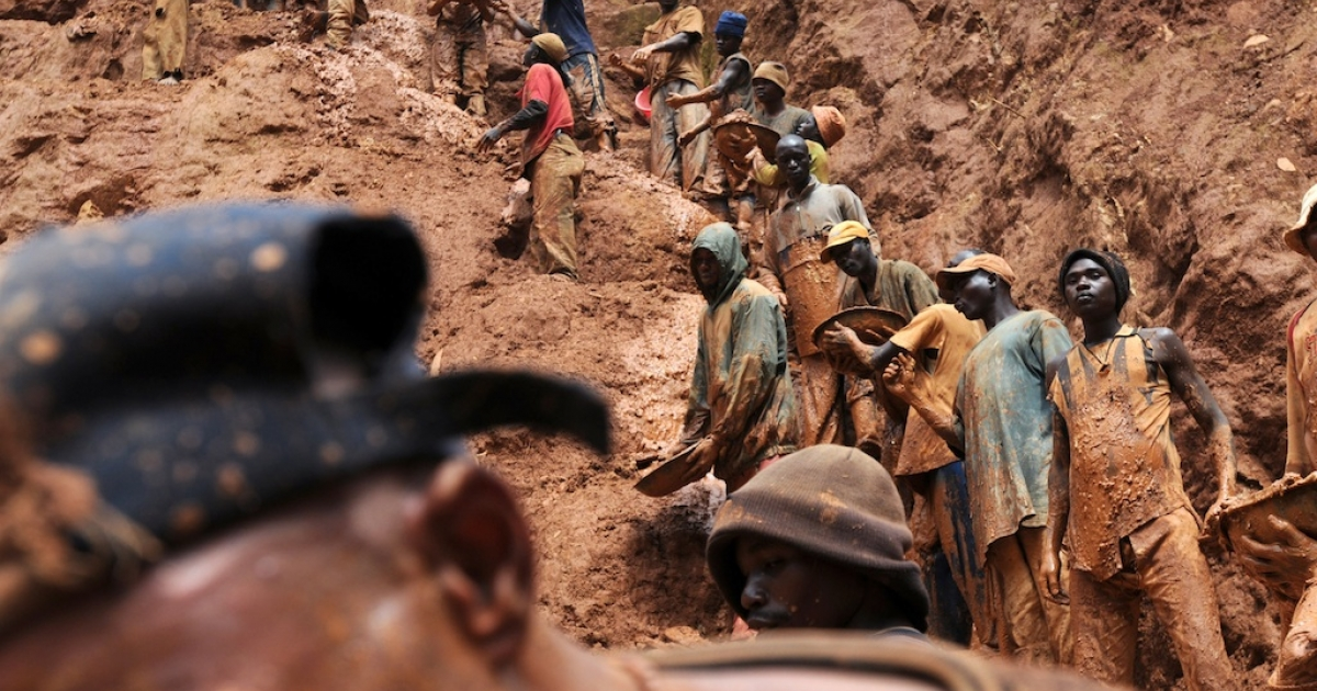 Men work in a gold mine on Feb. 23, 2009, in Chudja, near Bunia in north eastern Congo. The conflict in Congo has often been linked to a struggle for control over its resources.</p>