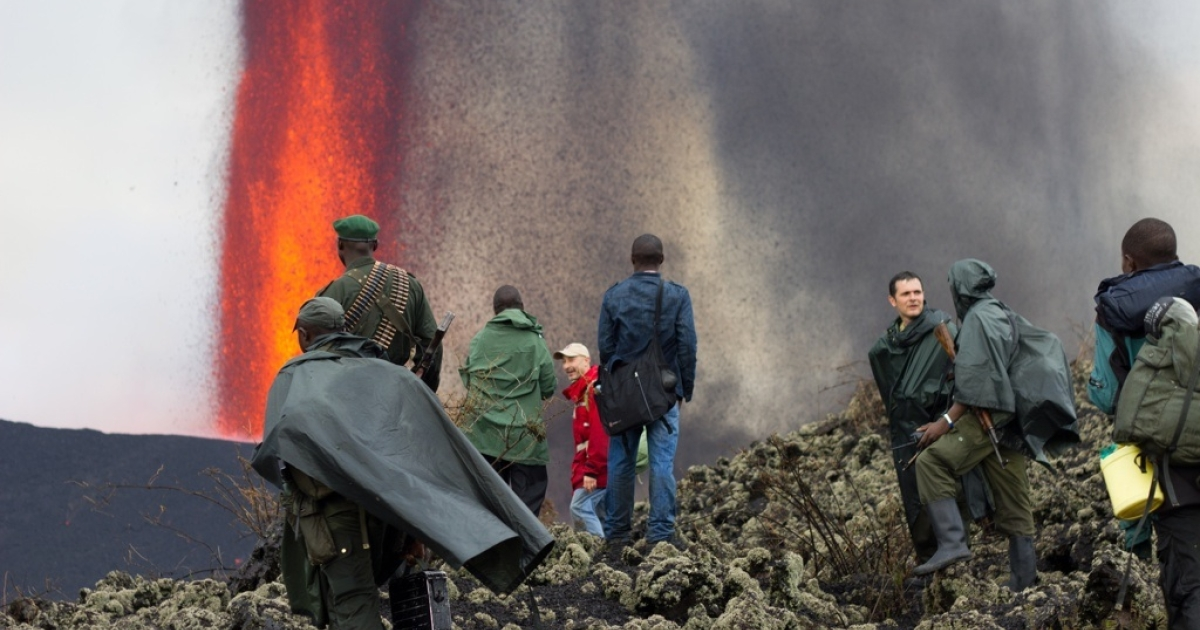 In Virunga National Park, tourists and park rangers view the lava fountain of Mount Nyamulagira.</p>