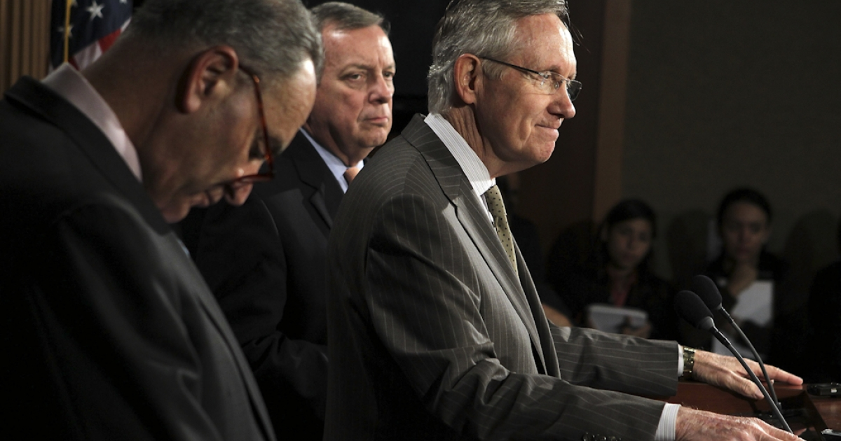 U.S. Senate Majority Leader Sen. Harry Reid (D-NV) (R) speaks as Sen. Charles Schumer (D-NY) (L), and Senate Majority Whip Sen. Richard Durbin (D-IL) listen during a news conference September 22, 2011 on Capitol Hill in Washington, DC. The Senate Democratic leaders discussed the Disaster Relief Funding at the news conference.</p>