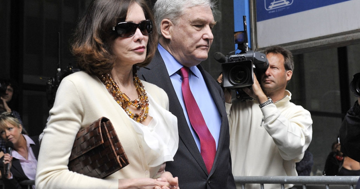 Former press magnate Conrad Black and wife Barbara Amiel leave federal court in Chicago where he was re-sentenced to 3 1/2 years in prison on June 24, 2011.</p>