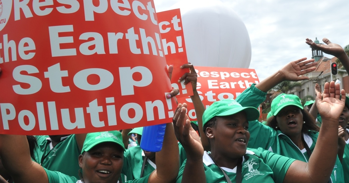 Hundreds of protesters march in on December 3, 2011 at the UN climate talks in Durban. The 12-day climate change conference will include talks between the representatives of 194 nations, under the UN Framework Convention on Climate Change (UNFCCC) end on December 9.</p>