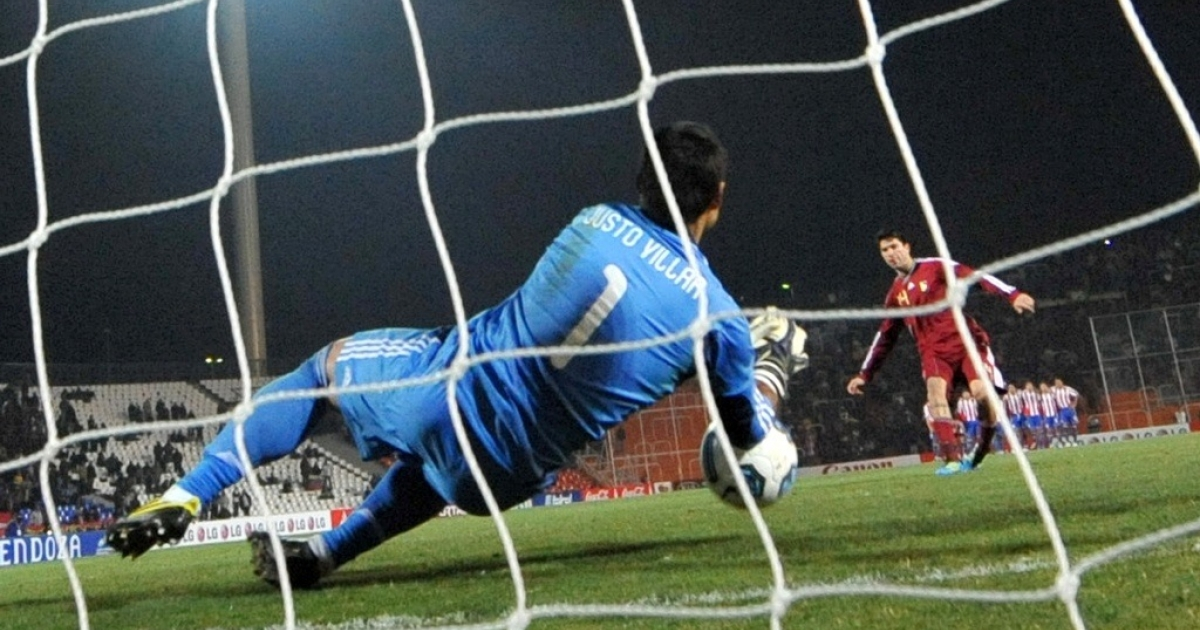 Paraguayan goalkeeper Justo Villar saves a penalty kick shot by Venezuelan midfielder Franklin Lucena.</p>