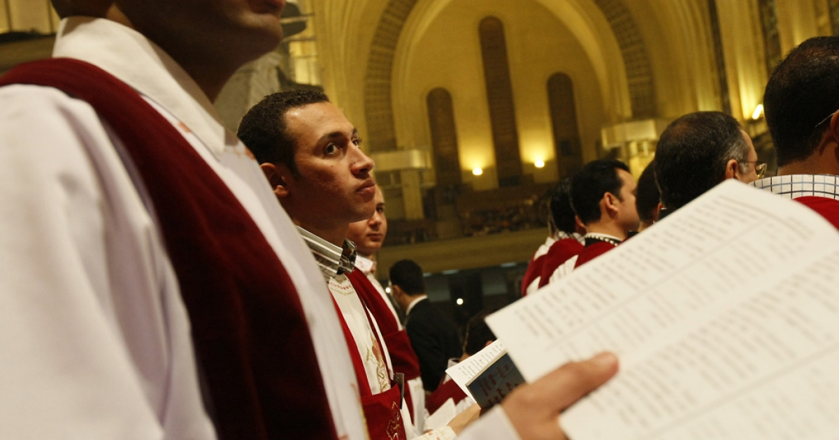 Egyptian Coptic Christian choir members get ready for Christmas midnight mass in Abassiya Cathedral in Cairo on Jan. 6, 2011.</p>