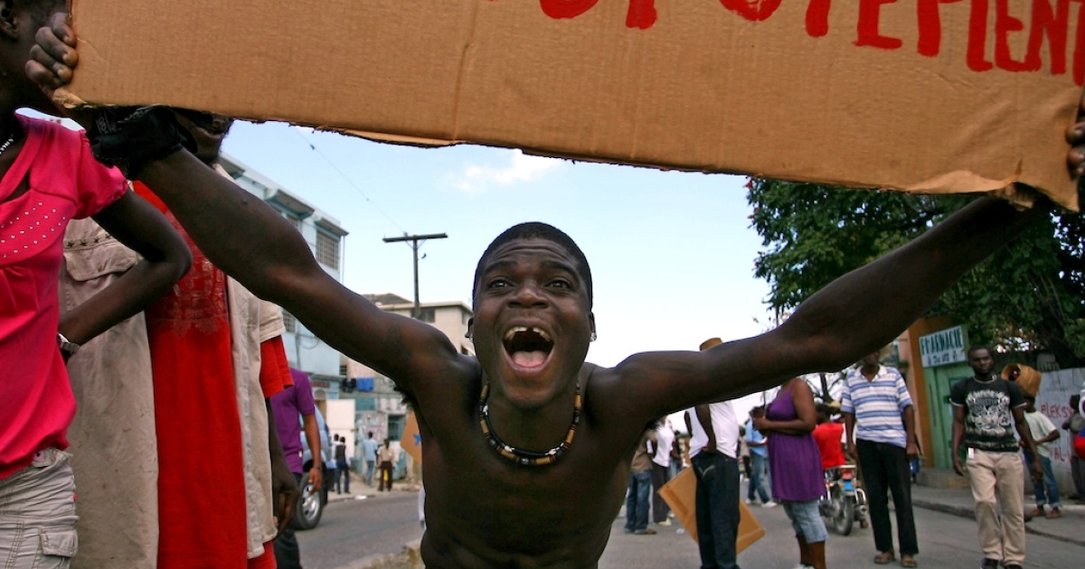 A man protests political corruption at a demonstration in Port-au-Prince, Haiti, on January 23, 2011.</p>