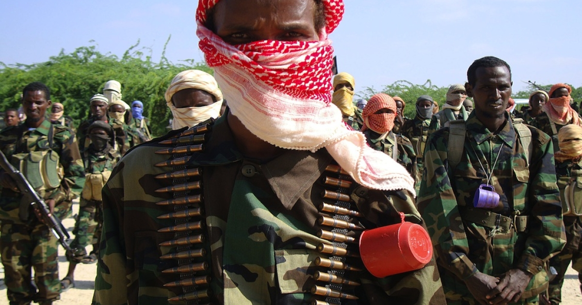 #182 — Somalia<br />Recently trained Al Shabaab fighters stand during a military exercise in northern Mogadishu's Suqaholaha neighborhood on Jan. 1, 2010.</p>